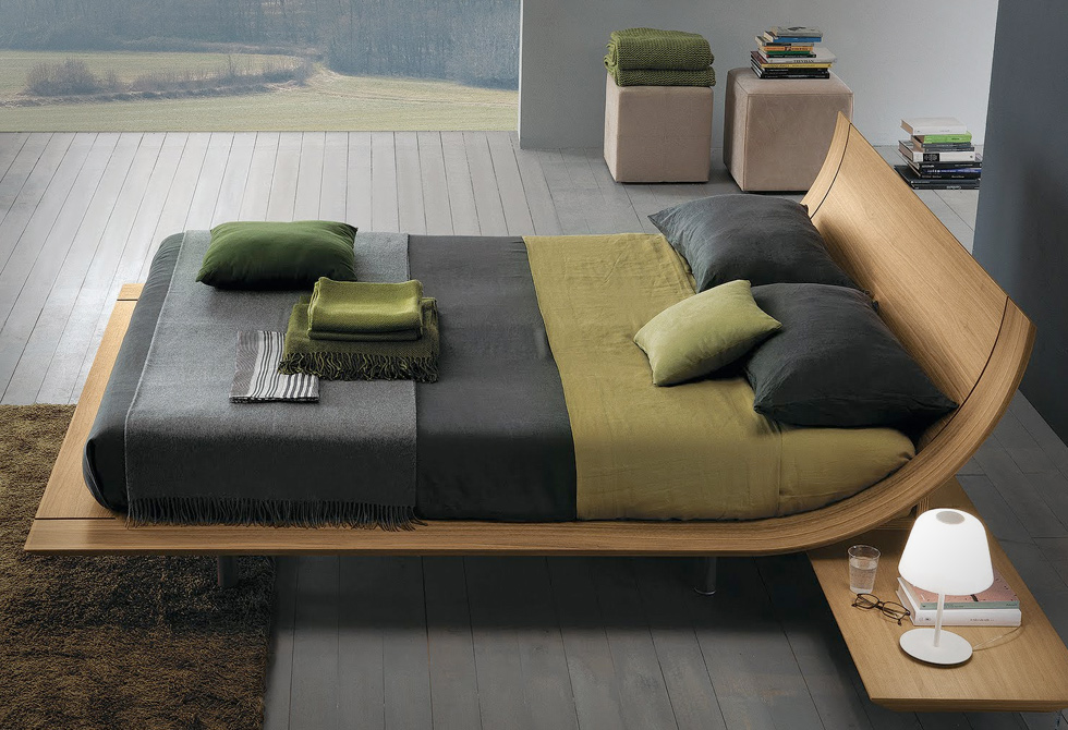 When I first saw the Aqua Bed, my jaw dropped. I loved every aspect of it.  Designed by Presotto, the curved bent plywood creates a simple platform  style.
